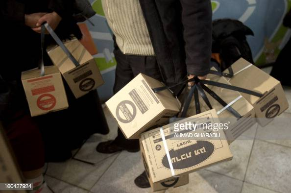 An Israeli man is pictured after picking up gas masks from a distribution center at a shopping center in Pisgat Zeev in East Jerusalem on January 31...
