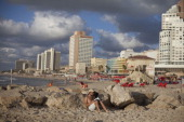 An Israeli man is seen reading a book at the beach on October 03 2013 in Tel Aviv Israel