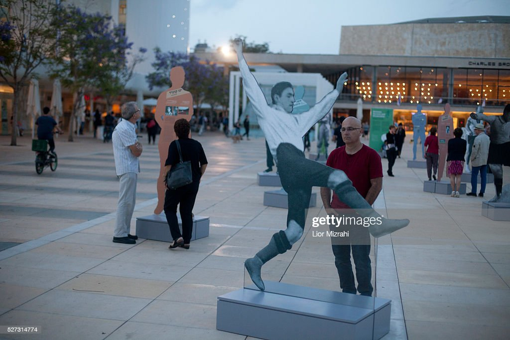 An Israeli man watches ' Between success and persecution' exhibition on May 2, 2016 in Tel Aviv, Israel. The exhibition includes images of Jewish soccer stars life-size and honors some Jewish people who were important in the development of football in Germany .