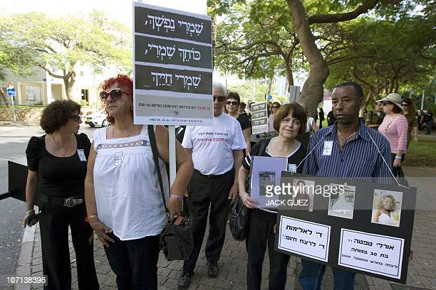 An Israeli man whose sister was violently killed by her partner joins marchers in a mock funeral to raise the alarm over the growing number of women...