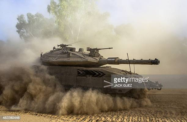 An Israeli Merkava tank deploys at an army deployment area near Israel's border with the Gaza Strip on July 17 2014 Fighting between Israel and Hamas...