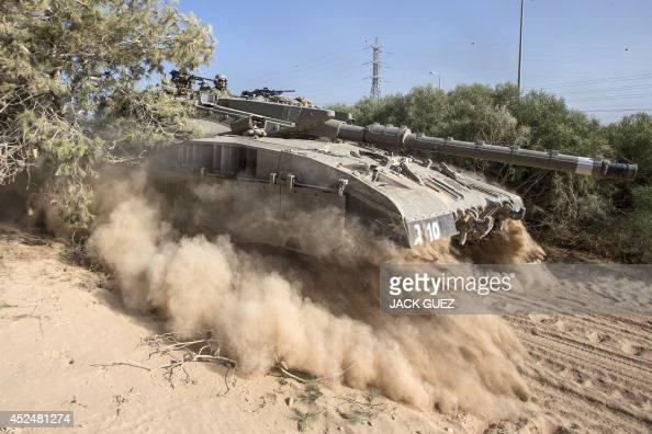 An Israeli Merkava tank rolls near the IsraeliGaza Strip border on July 21 2014 US Secretary of State John Kerry is to push for an immediate...