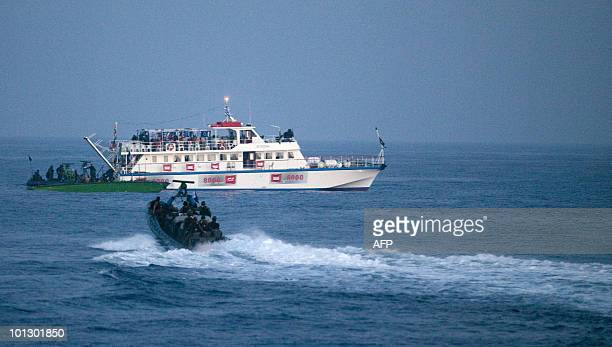 An Israeli military boats approach a ship as the navy intercepts a Gazabound aid flotilla in the Mediterranean Sea on May 31 2010 in a predawn...
