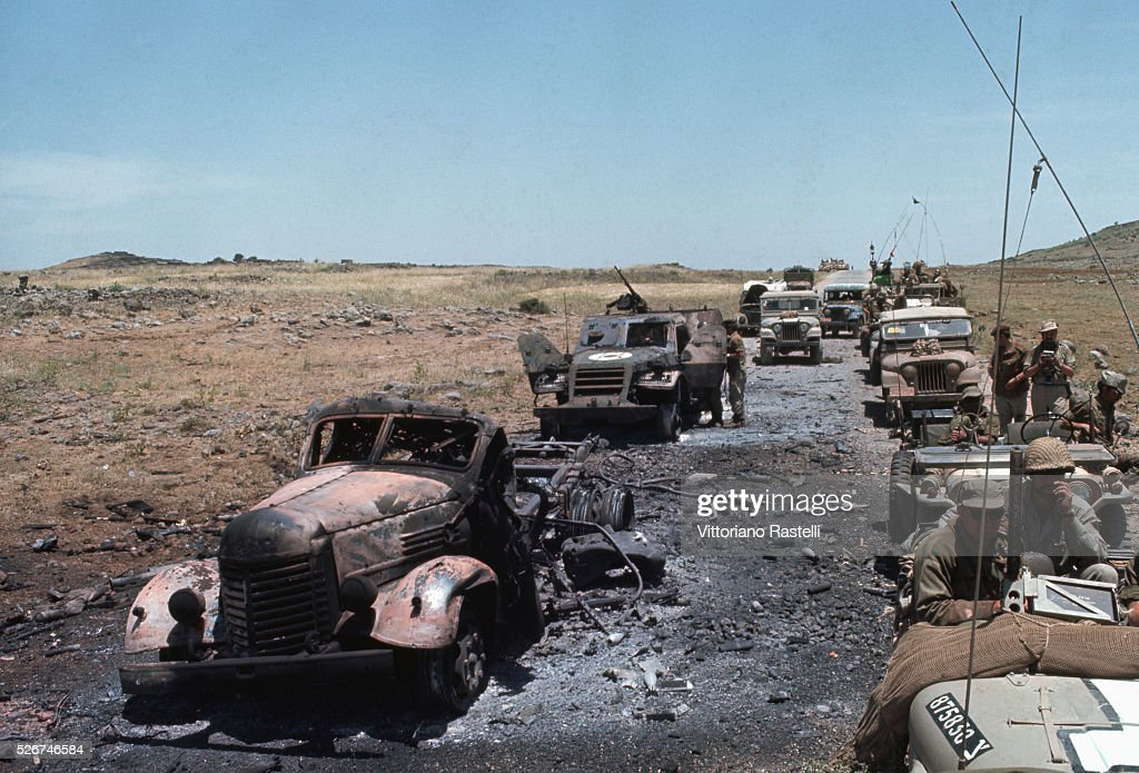 An Israeli military convoy passes destroyed vehicles during the Six-Day War. By June 10, 1967, when the fighting was halted, Israel had won territory four times the area of its territory in 1949, with an Arab population of 1.5 million.