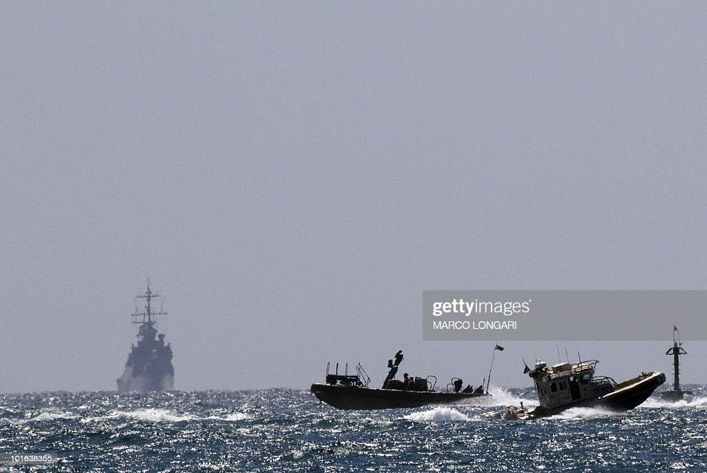 An Israeli military vessel (L) rrives at the navy port of Ashdod in southern Israel on June 5, 2010. Israeli troops boarded the Rachel Corrie aid ship heading for Gaza, but there was no violent confrontation, a military spokeswoman said.