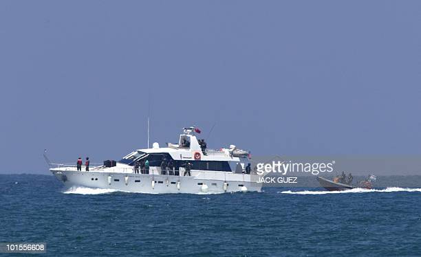 An Israeli navy rubber boat escorts a yacht from the Gazabound aid flotilla with Israeli troops on board as it enters the southern port of Ashdod on...
