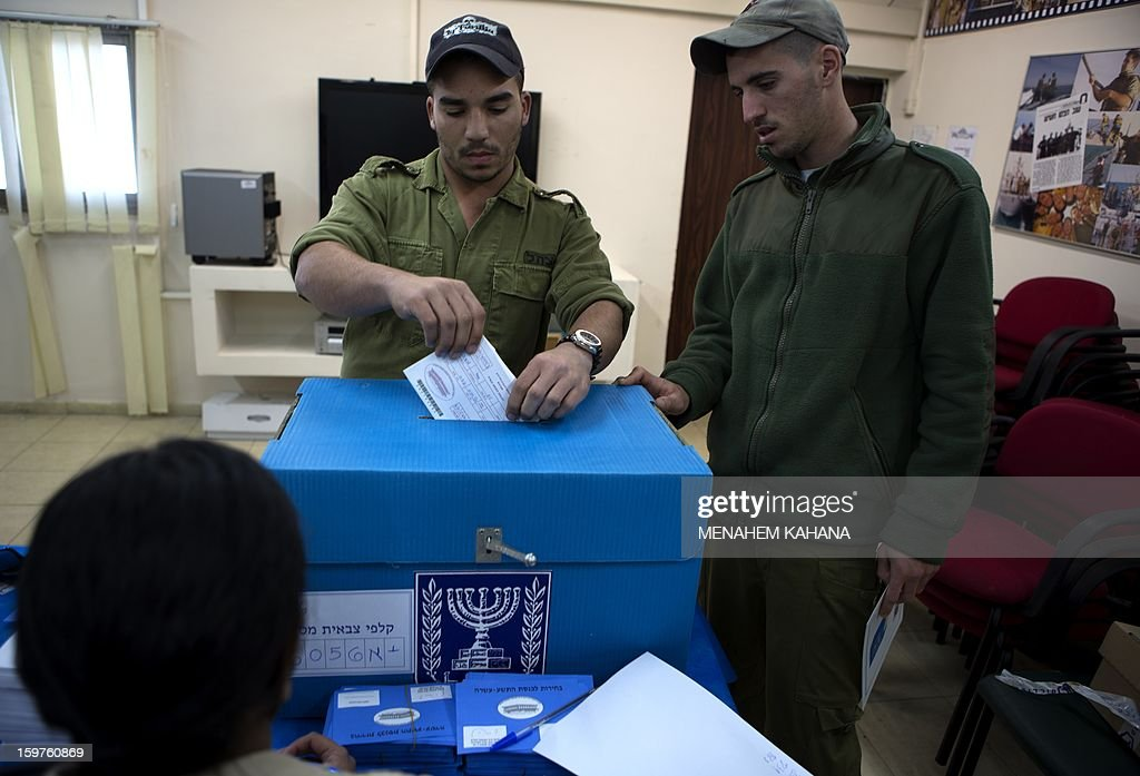 An Israeli Navy soldier casts his vote at an army Navy base in Ashdod, on January 20, 2013. Israeli soldiers started to vote for the 19th Israeli general election. Thirty-eight parties are running on 34 lists in Israel's general election to be held on January 22. AFP PHOTO/MENAHEM KAHANA