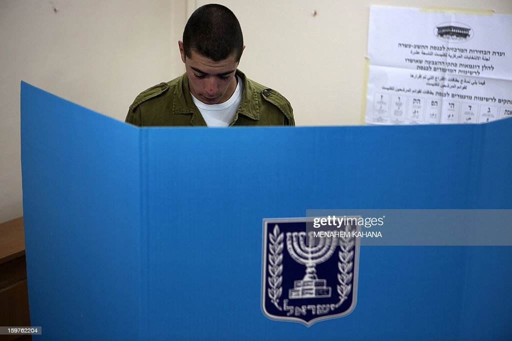 An Israeli Navy soldier stands in a voting booth at an army Navy base in Ashdod, on January 20, 2013. Israeli soldiers started to vote for the 19th Israeli general election. Thirty-eight parties are running on 34 lists in Israel's general election to be held on January 22. AFP PHOTO/MENAHEM KAHANA