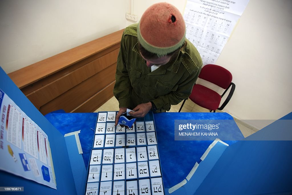 An Israeli Navy soldier takes ballot papers prior to vote at an army Navy base in Ashdod, on January 20, 2013. Israeli soldiers started to vote for the 19th Israeli general election. Thirty-eight parties are running on 34 lists in Israel's general election to be held on January 22.
