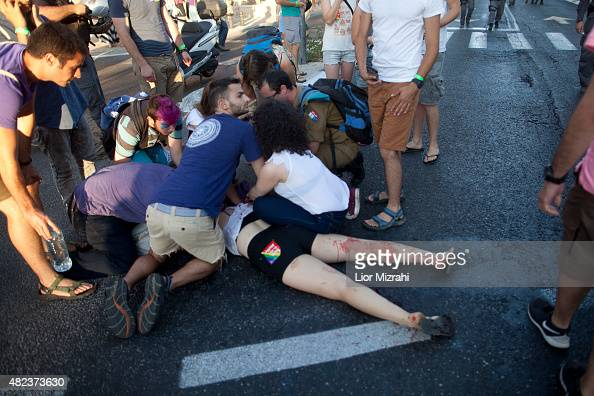 An Israeli person who was wounded recieves treatment during the gay parade on July 30 2015 in Jerusalem Israel At least six people were stabbed at...