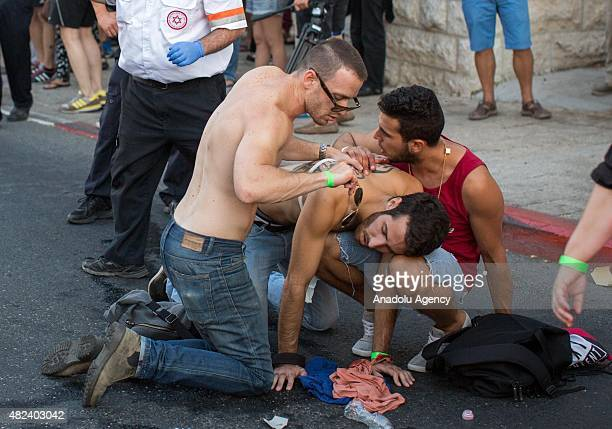 An Israeli person who was wounded recieves treatment during the gay parade on July 30 2015 in Jerusalem Israel At least six people were stabbed by an...