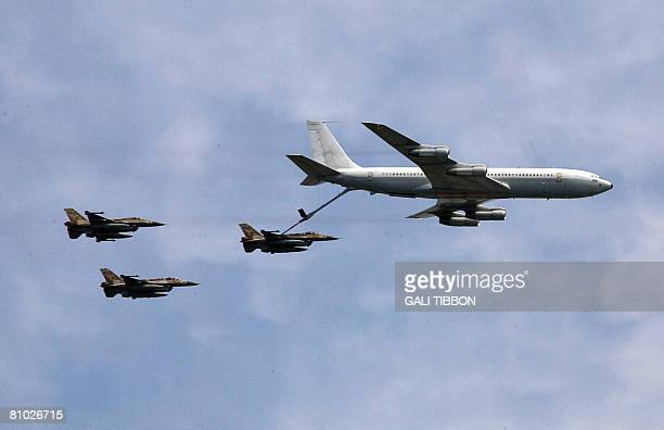 An Israeli plane KC135 Stratotanker Boeing 707 refuels an F16C Fighting Falcon during a military parade marking Israels 60th anniversary on May 8...