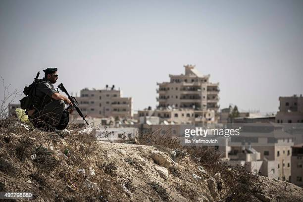 An Israeli police officer keeps guard in an East Jerusalem neighbourhood on October 15 2015 in Jerusalem Israel The Israeli Government issued police...