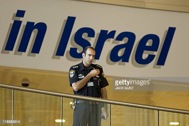 An Israeli police officer stands guard at Ben Gurion Airport on July 7 2011 as part of preparations for the arrival of a 'ProPalestinian FlyIn'...
