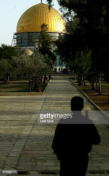 An Israeli policeman looks towards the golden Dome of the Rock Islamic shrine on April 7 2005 in Jerusalem's Old City Israel Israel's Shin Bet...