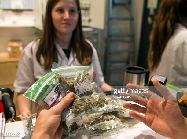 An Israeli prescriptioncarrying patient purchases medical marijuana at a dispensary by Israeli medical cannabis company Tikun Olam in the coastal...