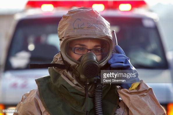 An Israeli rescue worker wears a DuPont protective suit as she deploys outside a shopping mall during a training exercise simulating a chemical...