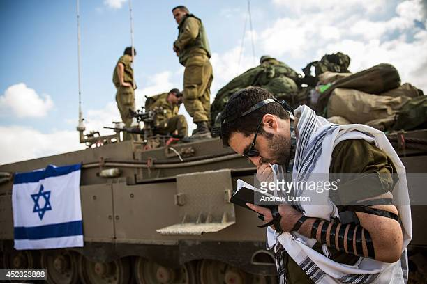 An Israeli reservist troop prays near the IsraeliGaza border on the morning of July 18 2014 near Sderot Israel Late last night Israeli forces...