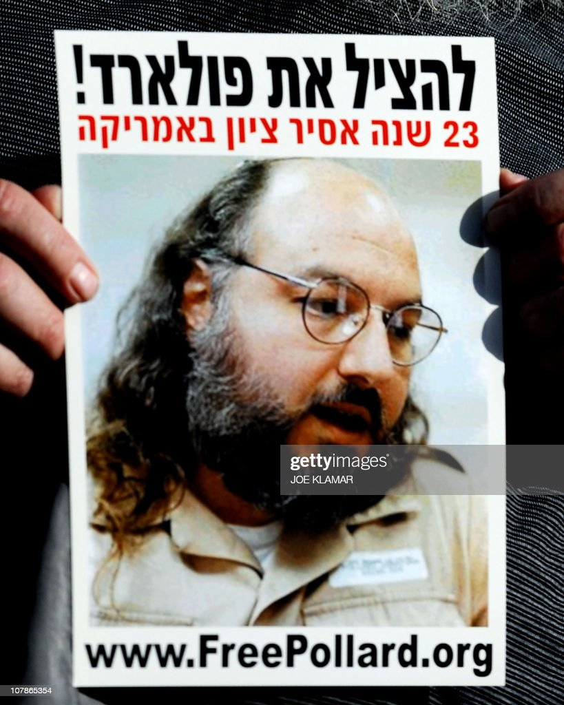 -- An Israeli right-wing demonstrstor holds a picture of Jonathan Pollard, a Jewish American who was jailed for life in 1987 on charges of spying on the United States, during a demonstration in Jerusalem on May 12, 2008. The White House will examine a request from Israeli Prime Minister Benjamin Netanyahu to pardon Jonathan Pollard, an American who spied for the Jewish state, an official January 04, 2011.