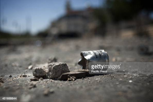 SHU'AFAT JERUSALEM ISRAEL An Israeli rubber bullet's cartridge is close to a rock used during clashes of the day before in Shu'afat as a reaction for...