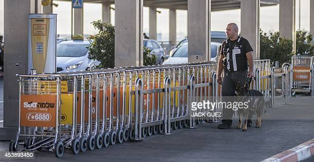 An Israeli security officer inspects the area outside the entrance of Ben Gurion International airport near the Mediterranean Israeli coastal city of...