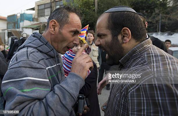 An Israeli settler argues with a Palestinian man in front of a disputed house occupied by Jewish settlers in east Jerusalem's mainly Arab Sheikh...