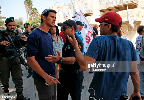 An Israeli settler argues with leftwing Israeli demonstrators in the centre of the divided city of Hebron during a protest called by NGO Peace Now to...