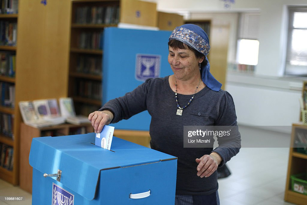 An Israeli settler casts her ballot at a polling station on election day on January 22, 2013 in the Jewish settelment of Ofra, West Bank. Israel's general election voting has begun today as polls show Netanyahu is expected to return to office with a narrow majority.