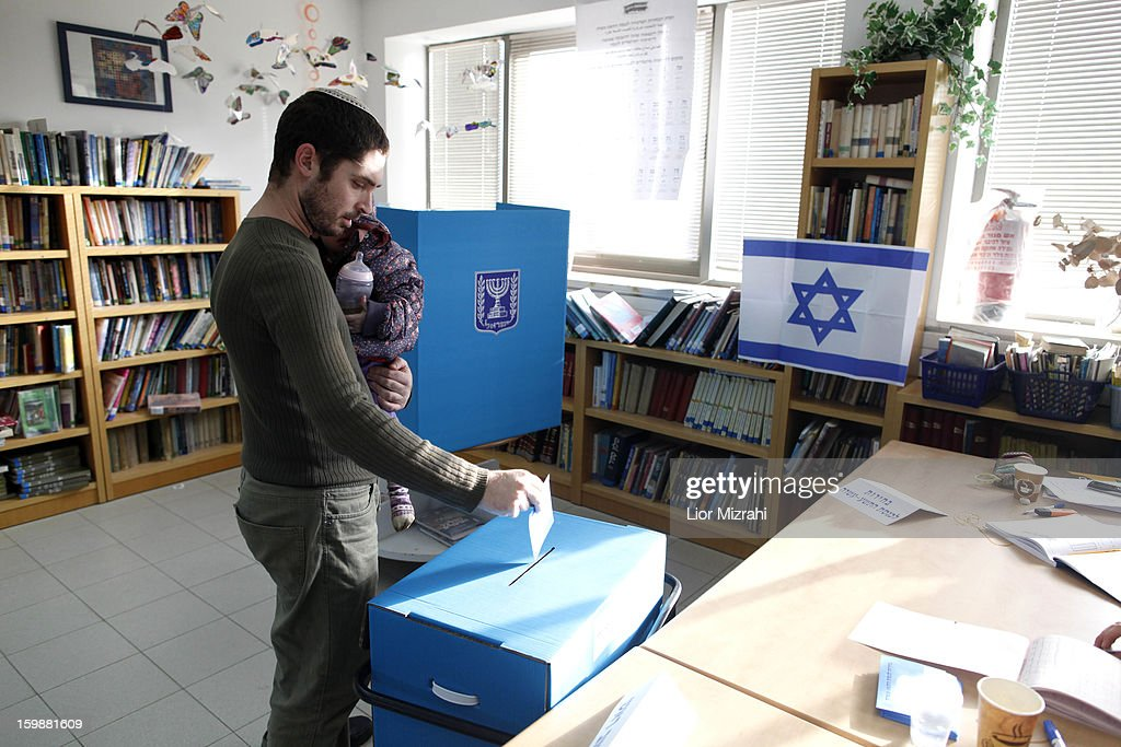 An Israeli settler casts his ballot at a polling station on election day on January 22, 2013 in the Jewish settelment of Ofra, West Bank. Israel's general election voting has begun today as polls show Netanyahu is expected to return to office with a narrow majority.