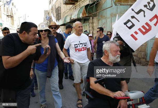 An Israeli settler harasses leftwing Isareli demonstrators in the centre of the divided city of Hebron during a protest called by NGO Peace Now to...
