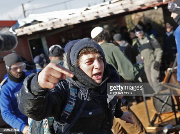 An Israeli settler reacts as Israeli police mobilise on the second day of an operation to evict the hardline occupants and their supporters from the...