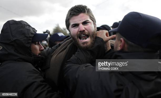 An Israeli settler scuffles with security forces at the Amona outpost northeast of Ramallah on February 1 2017 as they evict the occupants of the...