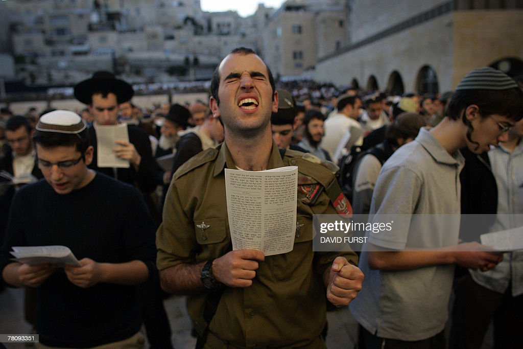 An Israeli soldier (C) along with thousands of Jewish men and women perform a special prayer in opposition to the US-hosted Middle East peace meeting at the Western Wall, Judaism's holiest site, in Jerusalem 26 November 2007. US President George W. Bush and Israeli Prime Minister Ehud Olmert expressed optimism today that the Annapolis conference would succeed where other peace efforts failed.