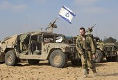 An Israeli soldier arrives at an army deployment area on the southern Israeli border with the Gaza Strip on August 1 2014 A threeday humanitarian...