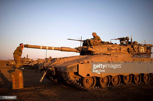 An Israeli soldier calibrates his tanks cannon at a deployment area during a military exercise on August 28 2013 near the border with Syria in the...