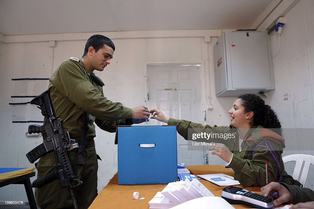 An Israeli soldier casts his vote at an army base on January 21, 2013 in Shekef, Israel. The Israeli general election will be held on January 22.