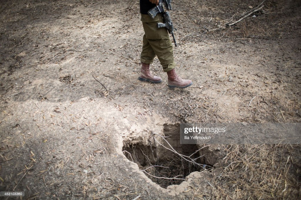 An Israeli soldier checks a hole in the ground while looking for signs of a tunnel from Gaza to Israel on August 3, 2014 near the border with Gaza, Israel. As Operation Protective Edge enters its 27th day, a large amount of Israeli ground troops are believed to have left the Gaza Strip.