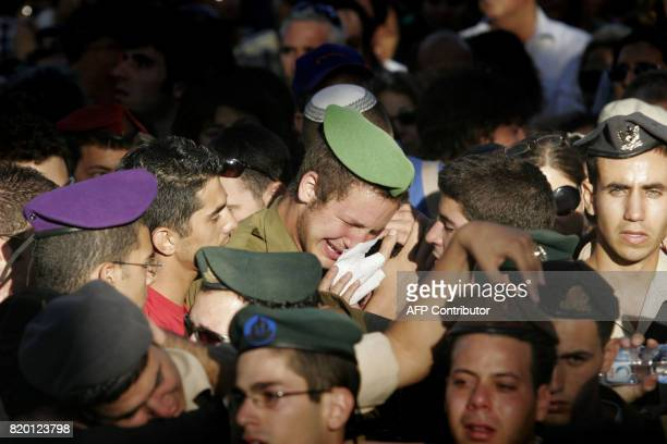 An Israeli soldier cries during the funeral of Sgt Nimrod Cohen 19yearsold killed in southern Lebanon yesterday during a military operation to...