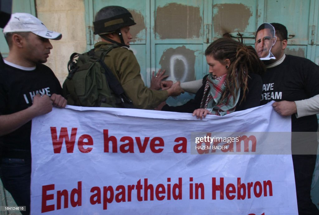 An Israeli soldier disperses a group of Palestinian and foreign protesters in the old city center of Hebron in the occoupied West Bank, as many Palestinians across the West Bank and Gaza demonstrated on March 20 , 2013 against a visit by US President Barack Obama to the region. Obama said in his arrival statement in Tel Aviv that the US is proud to stand with Israel as its strongest ally and greatest friend.