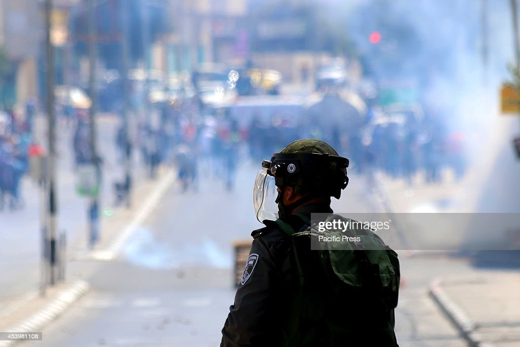 An Israeli soldier faces a crowd of Palestinian protesters. The Islamic Jihad faction organized protests in solidarity with Gaza, in the West Bank city of Bethlehem. As ceasefire talks collapsed completely in Cairo earlier this week, and fighting renewed on Wednesday. Hamas launched a barrage of rockets towards Southern Israel, some reaching as far as Jerusalem and illegal Israeli settlements in the West Bank, some 80 kilometers away from Gaza. Late Tuesday evening an Israeli missile struck the home of Hamas military commander Muhammad Deif, killing his wife and three-year-old daughter. Deif, according to Hamas reports was not assassinated. On Thursday, three more to military commanders, Muhammad Abu Shammala, Raed al-Attar and Muhammad Barhoum were also killed in airstrikes. In response, Hamas killed what they believed to be collaborators with Israel in Gaza. 18 suspected of having worked with Israeli army intelligence have been killed so far. Late Friday afternoon, a four-year-old Israeli child from Nihal Oz was killed by mortar fire from Gaza. To date, the death toll from the Gaza war stands at 2090 Palestinians and 67 Israelis.