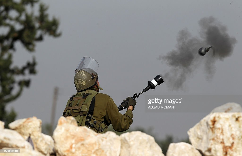 An Israeli soldier fires a tear gas canisters at Palestinian protestors during a demonstration in the West Bank village of Budrus, on January 18, 2013. The Palestinians are bracing for a new right-wing government that Israel's election is expected to produce, hoping that international and domestic moves will strengthen their position.