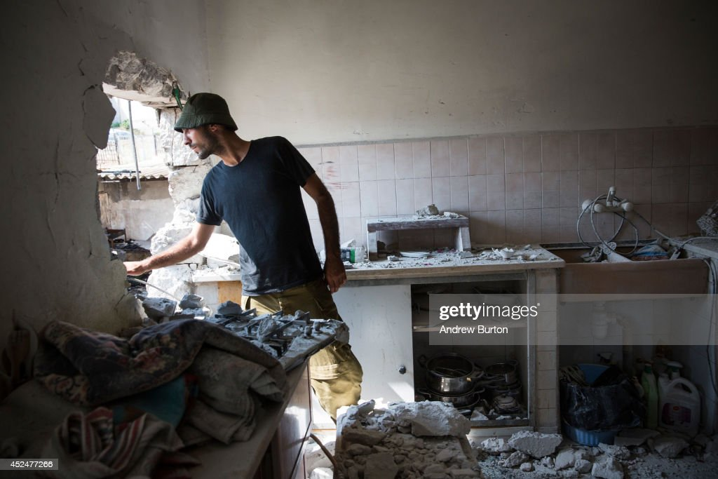 An Israeli soldier inspects an Israeli home allegedly hit by a Hamas rocket on July 21, 2014 in Sderot, Israel. Yesterday marked the bloodiest day of the operation 'Protective Edge' yet, as 13 Israeli soldiers died and the death toll in Gaza passed 500 people.