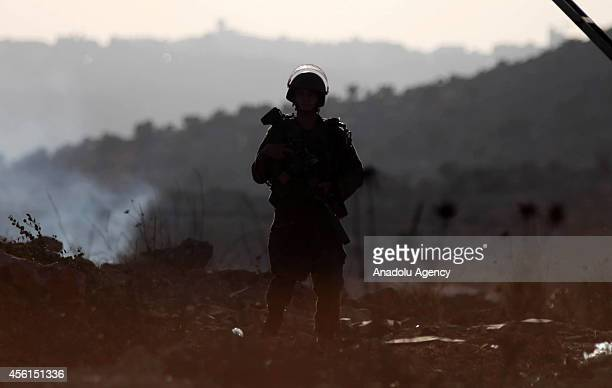 An Israeli soldier is seen during the clashes with Palestinians following a protest against the expropriation of Palestinian land by Israel and the...