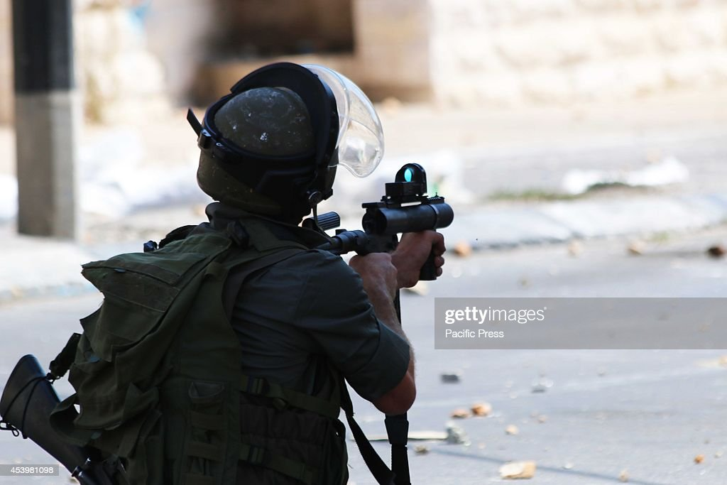 An Israeli soldier looks through the scope of his tear gas gun, aiming at Palestinian protesters. The Islamic Jihad faction organized protests in solidarity with Gaza, in the West Bank city of Bethlehem. As ceasefire talks collapsed completely in Cairo earlier this week, and fighting renewed on Wednesday. Hamas launched a barrage of rockets towards Southern Israel, some reaching as far as Jerusalem and illegal Israeli settlements in the West Bank, some 80 kilometers away from Gaza. Late Tuesday evening an Israeli missile struck the home of Hamas military commander Muhammad Deif, killing his wife and three-year-old daughter. Deif, according to Hamas reports was not assassinated. On Thursday, three more to military commanders, Muhammad Abu Shammala, Raed al-Attar and Muhammad Barhoum were also killed in airstrikes. In response, Hamas killed what they believed to be collaborators with Israel in Gaza. 18 suspected of having worked with Israeli army intelligence have been killed so far. Late Friday afternoon, a four-year-old Israeli child from Nihal Oz was killed by mortar fire from Gaza. To date, the death toll from the Gaza war stands at 2090 Palestinians and 67 Israelis.