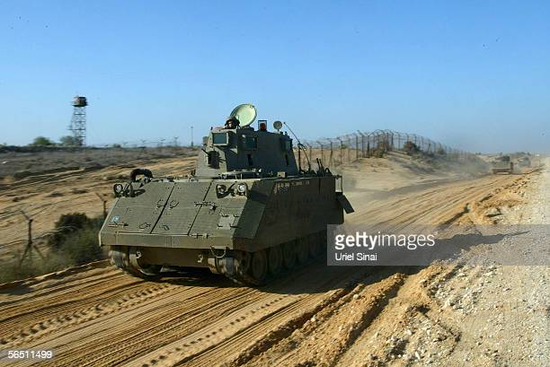 An Israeli soldier mans an armoured personal carrier as additional troops are deployed January 2 2006 near Kerem Shalom along Israel's southern...
