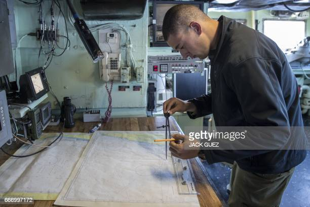 An Israeli soldier onboard the Israeli vessel Saar 5 Class Corvette 'INS Hanit' takes part in a training session during the 'Novel Dina 17' exercise...