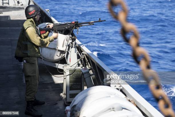 An Israeli soldier onboard the Israeli vessel Saar 5 Class Corvette 'INS Hanit' takes part in the 'Novel Dina 17' training session in the...