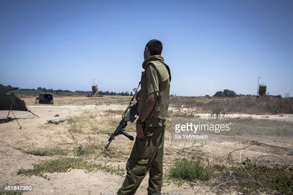 An Israeli soldier patrols near an Iron Dome system on July 8 in Ashkelon Israel Due to recent escalation in the region the Israeli army started new...