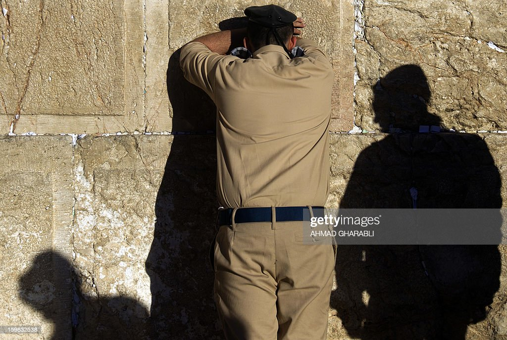 An Israeli soldier prays in front of the Western Wall, Judaism's holiest prayer site, in Jerusalem's Old City, on January 21, 2013.