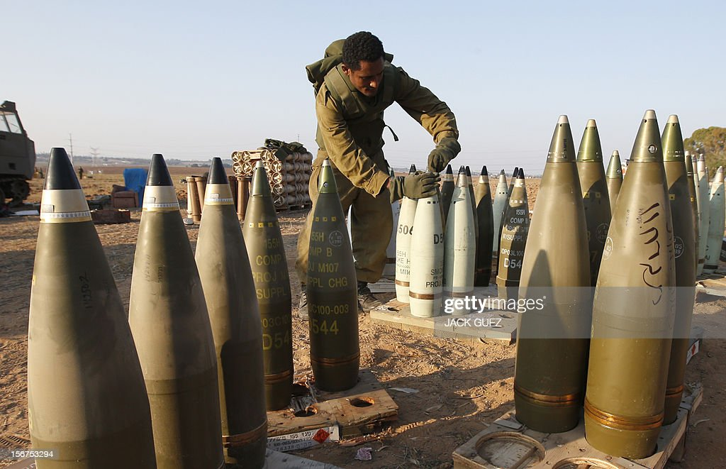 An Israeli soldier prepares artillery shells as troops keep position on November 20, 2012 on the Israel-Gaza border. A ceasefire to end almost a week of violence in and around the Gaza Strip is to be announced in Cairo, Hamas and Islamic Jihad sources told AFP.